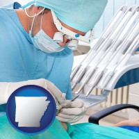 ar an oral surgeon operating on a dental patient