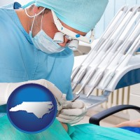 nc an oral surgeon operating on a dental patient