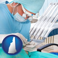 nh an oral surgeon operating on a dental patient